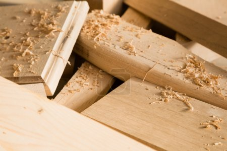 Photo for Wooden sticks lie on a workbench in the carpentry workshop - Royalty Free Image