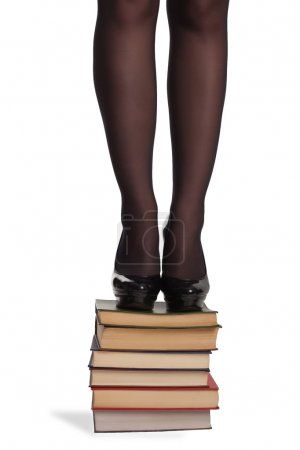 Legs of woman with books