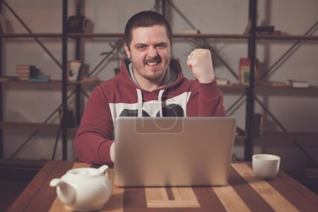 Happy man with laptop