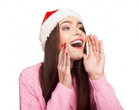 Photo pour Jeune modèle dans le chapeau du Père Noël appeler quelqu'un - image libre de droit