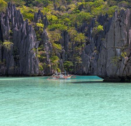 Landscape with filippino boat, rocks and blue bay. El Nido,  Pal