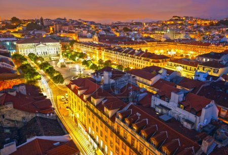 Rossio Square at night and Maria II Theatre. View from Santa Jus
