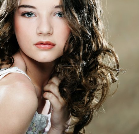 Photo for Image of beautiful young woman with curly hair - Royalty Free Image