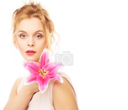 Photo for Beauty face of the young woman with pink lily isolated on white - Royalty Free Image
