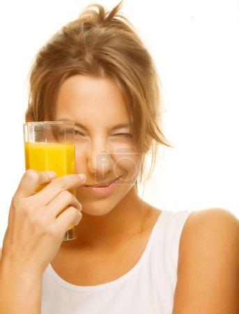 woman drinking orange juice close up