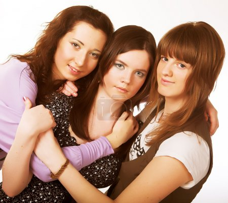 Photo for Portrait of three smiling attractive girlfriends  isolated on white - Royalty Free Image
