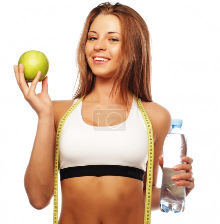 Healthy woman with water and apple diet smiling is...
