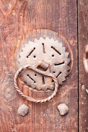 Old door knock with dust