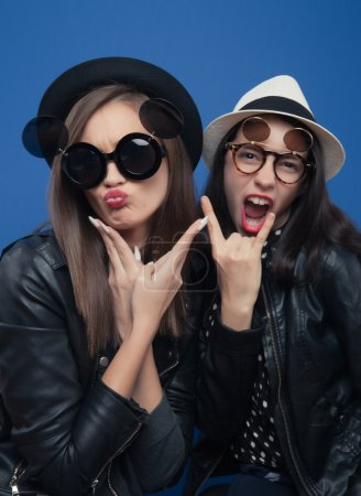 Two girls posing in photo boot