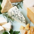 Assorted cheese on wooden table, rich and healthy ...