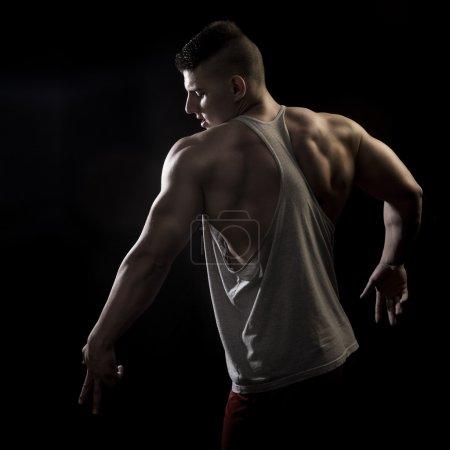 Athlete men on dark backgrounds