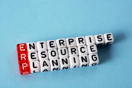 Photo for ERP Enterprise Resource Planning   written  on  cubes on blue  background - Royalty Free Image