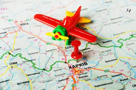 Close up of Kharkov, Ukraine , map and airplane to...