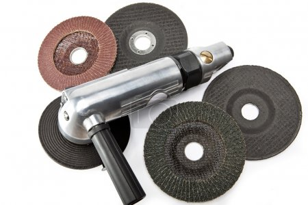 air angle grinder and different grinding wheels on white backgroun