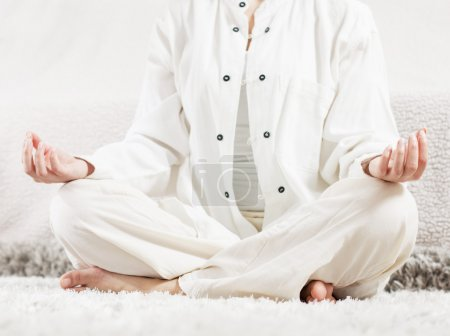 Photo for Yoga Meditation Woman Relaxing at home.Healthy Lifestyle in Lotus Posture .Unrecognizable caucasian female meditate  on the floor. - Royalty Free Image