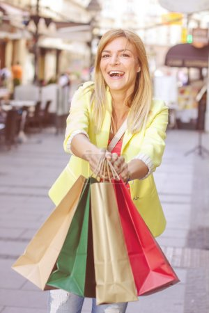 Photo for Happy Shopping Young Woman with bags on the street.Portrait urban caucasian female . - Royalty Free Image