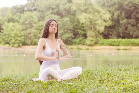 Photo for Yoga Meditating Relax Young Woman Outdoor. Healthy Lifestyle at beautiful summer day in nature. - Royalty Free Image