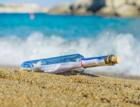 Photo for Bottle with a Message on the sandy beach. - Royalty Free Image