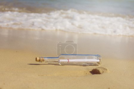 Photo for Message in a bottle , at sandy beach - Royalty Free Image