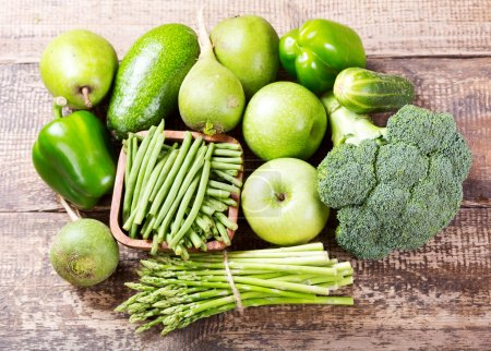 Photo for Green fruit and vegetables on wooden background - Royalty Free Image