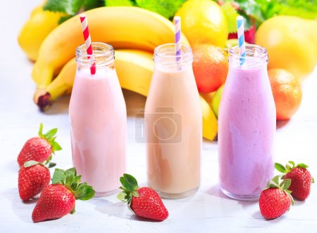 Photo for Various bottles of smoothie with fresh fruits - Royalty Free Image