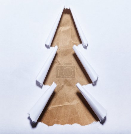 Photo for Photo of torn paper christmas tree on white - Royalty Free Image
