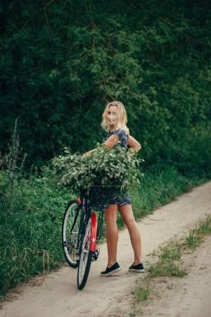 Photo of young beautiful girl with bicycle...