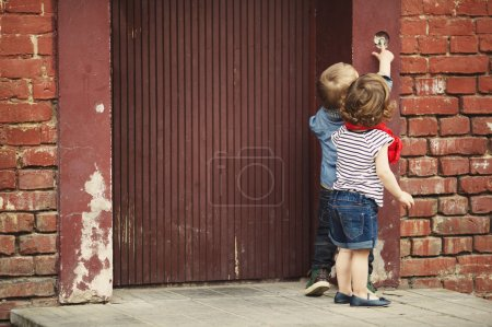 children play with intercom
