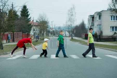 children crossing street on crosswalk
