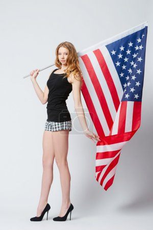 beautiful blonde girl with american flag