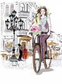 Divat lány lovagol a kerékpár a régi város utcáin