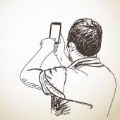 Man taking photo with smart phone
