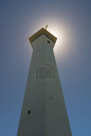 Lighthouse in front of Sun