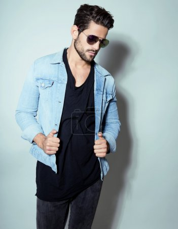 handsome young man in jeans jacket