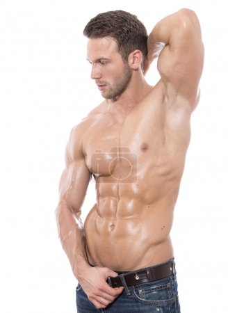 Young fit bodybuilder with perfect fit body