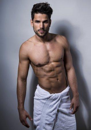 Handsome muscular young bodybuilder