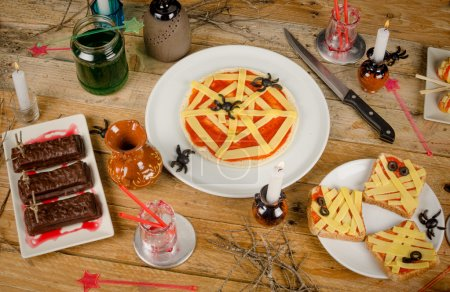 Photo for Assorted creative Halloween party food on a wooden table - Royalty Free Image