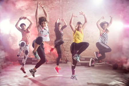 Fit young women dancing  and exercising