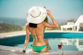back view of young woman in bikini