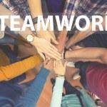 Students teamwork, all hands together...