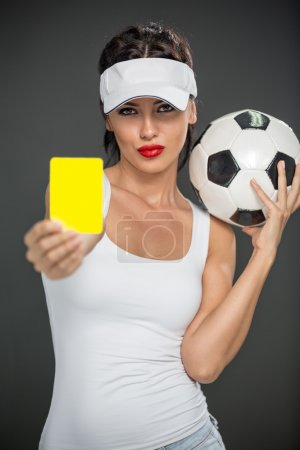 Woman  referee with yellow card