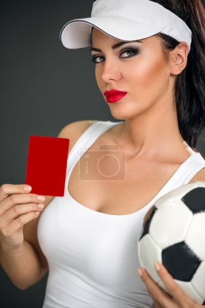 Cute young woman shoving red card