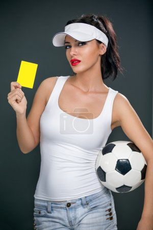 Attractive football referee with yellow card
