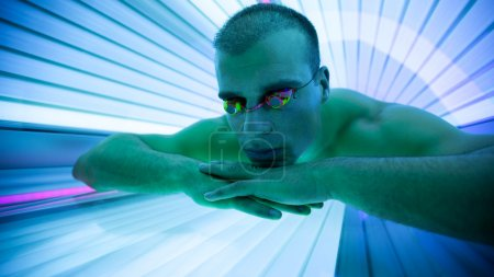 Handsome man in tanning booth
