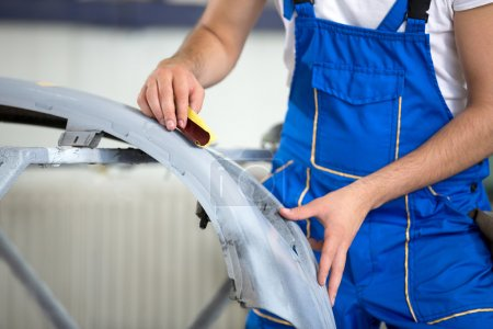 auto mechanic polishing part