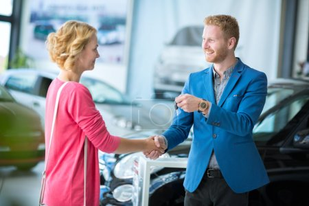 woman  getting car keys from a car seller