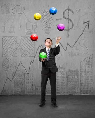 standing businessman playing currency symbol balls