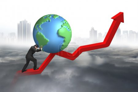 Businessman pushing 3d globe at starting point of trend line
