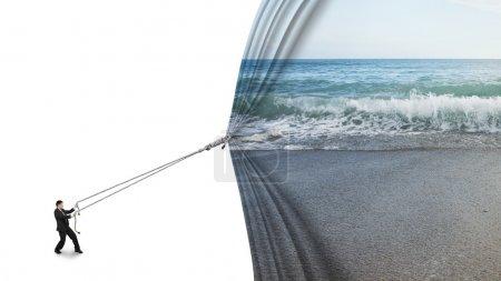 businessman pulling open sea sandy beach curtain covered blank w