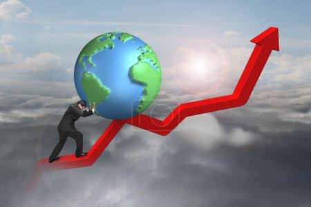 Photo pour Homme d'affaires poussant le globe vers le haut au point de départ de la ligne de tendance rouge avec fond nuageux de lumière du soleil - image libre de droit
